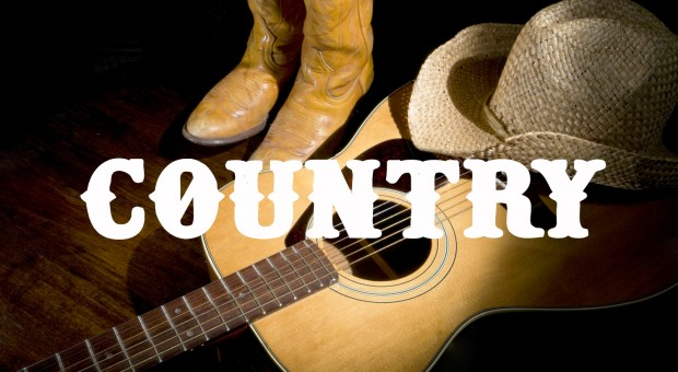 stock-photo-spotlight-on-country-guitar-boots-and-hat-131286074